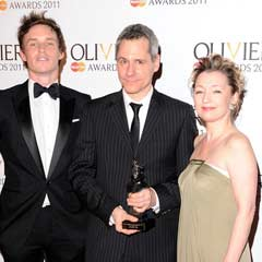Bruce Norris (centre) picks up his Olivier Award for Best New Play, posing with Eddie Redmayne and Lesley Manville