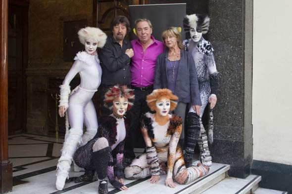 Trevor Nunn (left), Andrew Lloyd Webber and Gillian Lynne pose with some of the cast of the touring production of Cats, outside the London Palladium. Photo by Dan Wooller