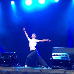 Tade Biesinger from Billy Elliot performs on a stage in Covent Garden for the Olivier Awards