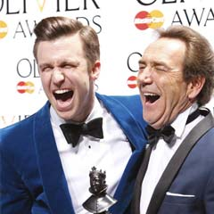 Best Actor in a Musical winner Gavin Creel (The Book Of Mormon) with presenter Robert Lindsay