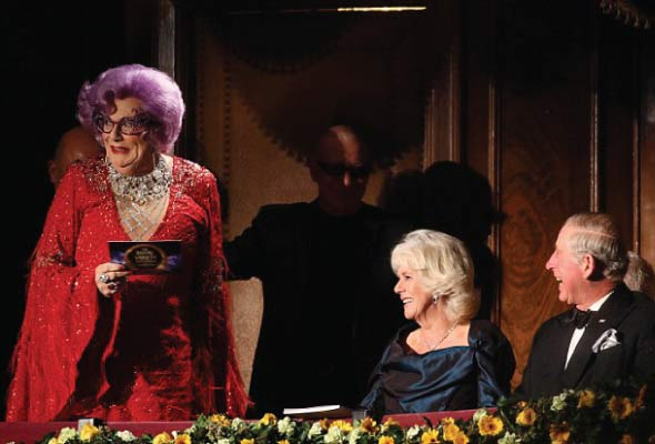 Dame Edna surprises Prince Charles and Camilla in the Royal Box. Photo copyright: ITV