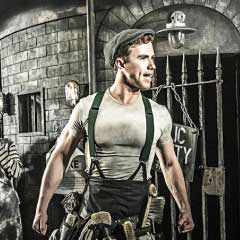 Richard Fleeshman in Urinetown at the St James Theatre