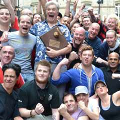Matthew Kelly and the cast of Lend Me A Tenor pick up the winning trophy